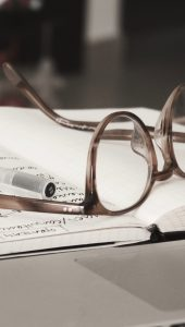glasses on a notebook